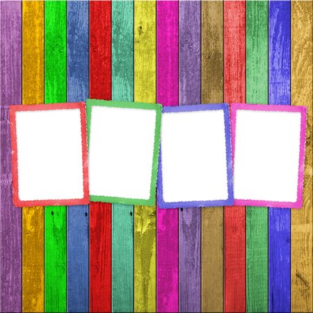 Four multicolored frames on the wooden background Stock Photo - 5607482