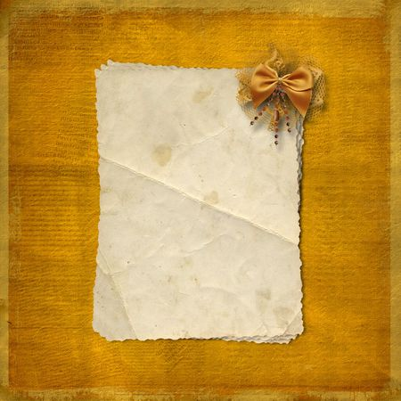antiquarian: Grunge paper on the abstract background wiht bow
