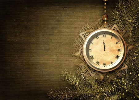 watch new year: Antique clock face with lace and firtree on the abstract background Stock Photo