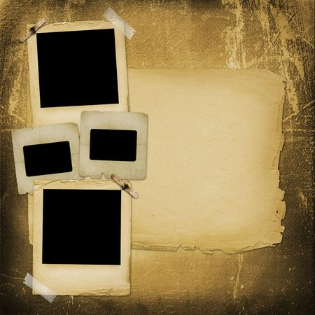 Old grunge paper slides on the ancient background photo