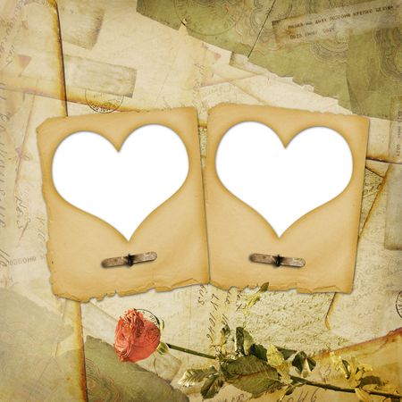 Old grunge paper frame with heart on the ancient background photo