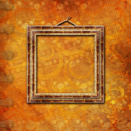 Wooden frame in Victorian style on the abstract ancient background  photo