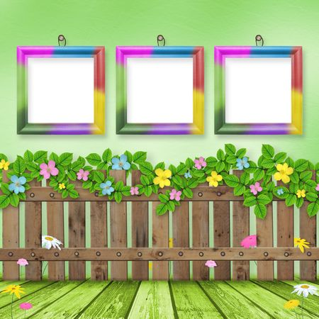Wooden fence with a flower garland on the background of a summer day Stock Photo - 6422048