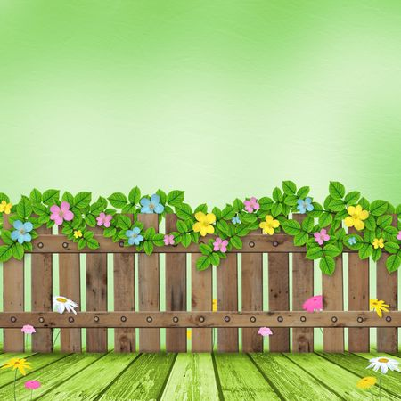 cartoon spring: Wooden fence with a flower garland on the background of a summer day Stock Photo