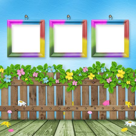 Wooden fence with a flower garland on the background of a summer day Stock Photo - 6466651