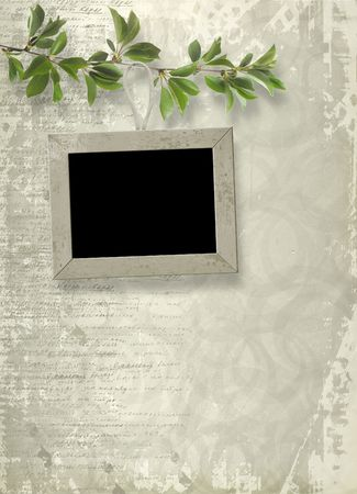 Wooden frame hanging from a tree branch on the grunge background photo