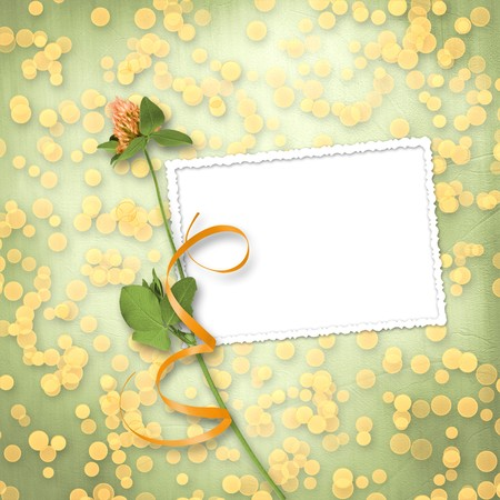 grunge paper for congratulation with bunch of clover Stock Photo - 6960341