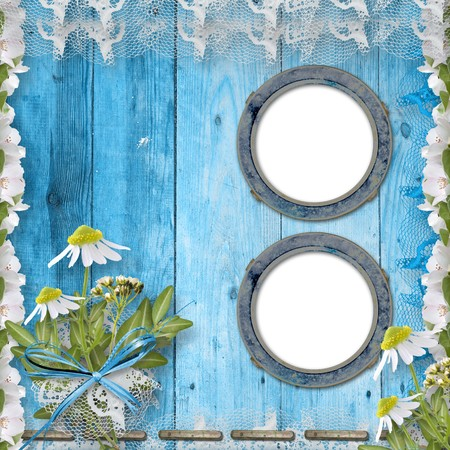 Grunge porthole with bunch of flower on the wooden background photo