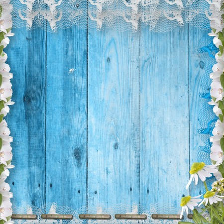 oxeye: Grunge wooden wall with bunch of flower and lace Stock Photo