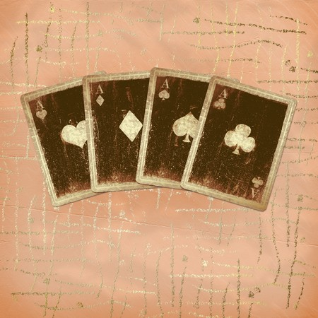 Grunge gold playing cards on the abstract background. photo
