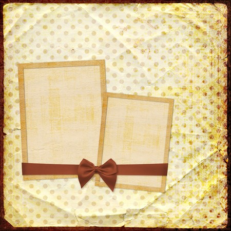 Old grunge photoalbum with paper frames for photos photo