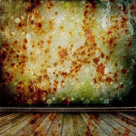 A rusty metal wall in the old room with wooden floor photo