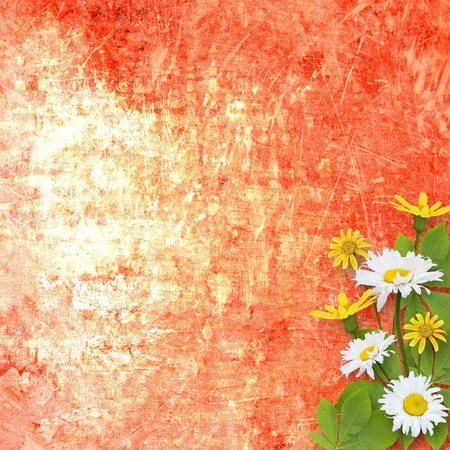 A cracked rusty metal wall with beautiful bunch of daisy for design photo