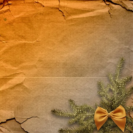 Festive invitation or greeting with firtree and bow photo