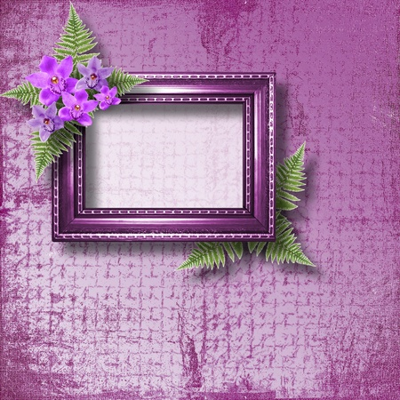 Wooden frame for photo with lilac orchids and green fern photo