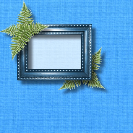 Wooden frame for photo with blue orchids and green fern photo