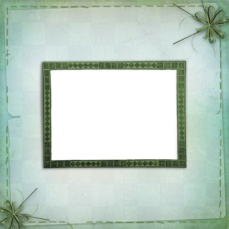 Green backdrop with frame for greetings or invitations photo