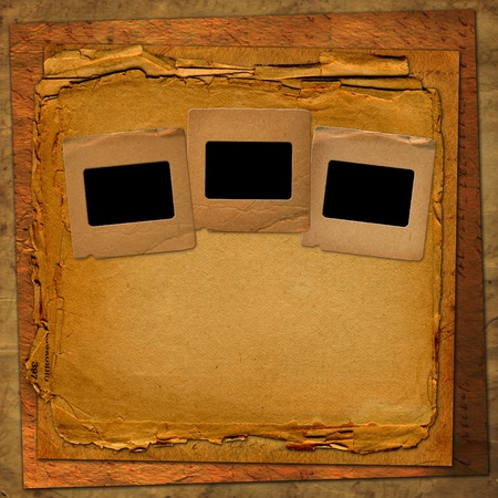 Old grunge frames on the ancient paper background photo
