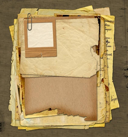 inscription notebook: Old archive with letters, photos on the abstract grunge background Stock Photo