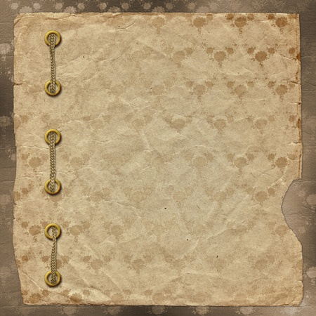 Old vintage album with cord and gold clips photo