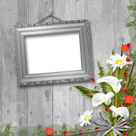 Grunge frame with bunch of flower on the wooden background photo