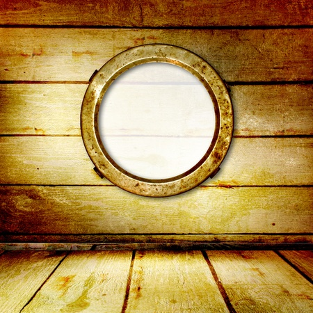 Grunge portholes on the ancient wooden background photo