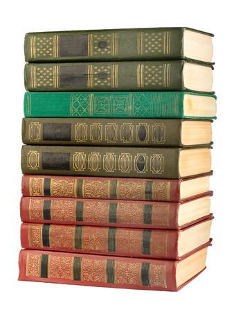 Old antique books on the white isolated background photo
