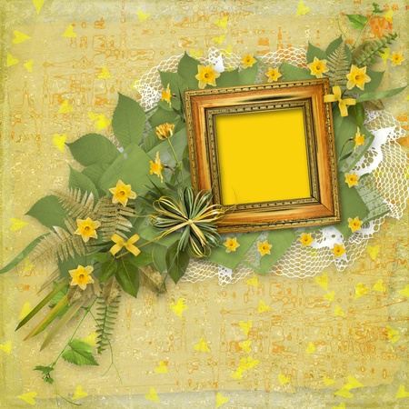 yellow photo: Old wooden frame for photo with bunch of flower