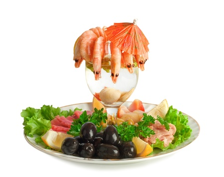 Appetizer of shrimp, fish, meats, olives and fresh vegetables photo
