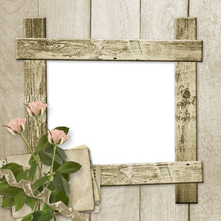 the album announcement: Old wooden background with frame and bunch of flower