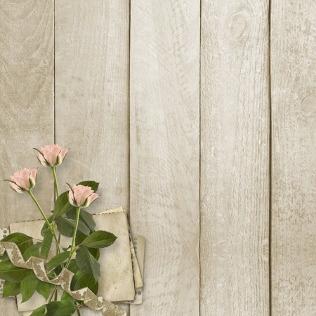 Old wooden background with frame and bunch of flower