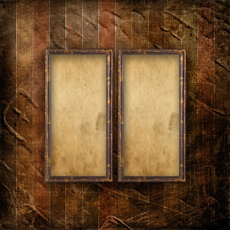 nostalgia: Old grunge frames on the ancient paper background