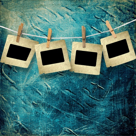 clothespeg: Old grunge slides on the abstract paper background