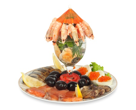 Appetizer of shrimp, fish, caviar, olives and fresh vegetables photo