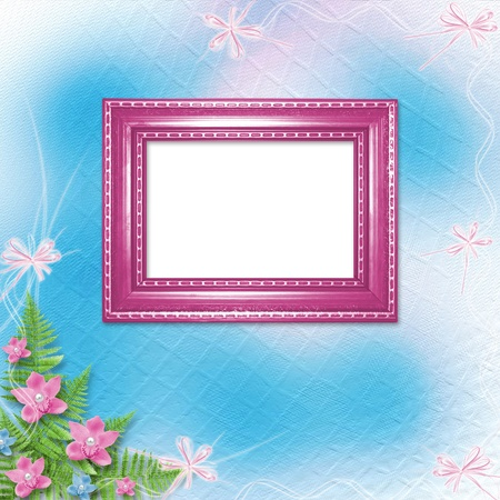 Wooden frame for photo with pink orchids and green fern  photo