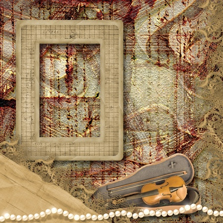 The old frame and violin in case on the vintage background photo