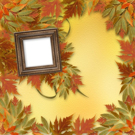 Bright autumn leaves on the abstract background with wooden frame Stock Photo - 10996931