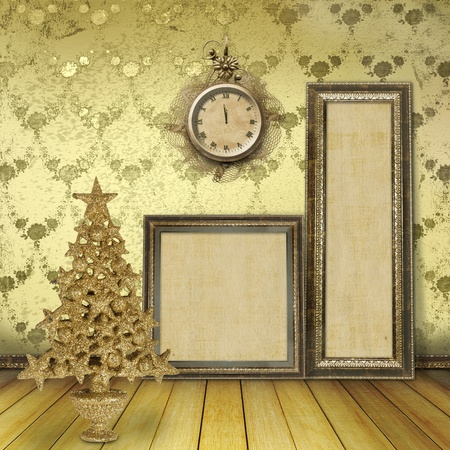 Christmas tree in the old room, with wooden frames for paintings and clocks photo