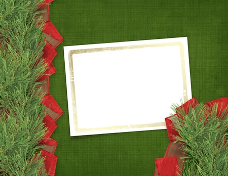 trumpery: Christmas greeting card with branches of spruce and ribbons Stock Photo