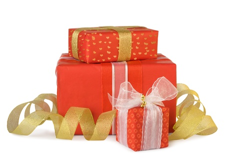 Holiday gift boxes decorated with bows and ribbons isolated on white background photo