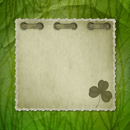 Grunge green background with ancient ornament for St. Patrick's Day photo