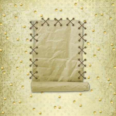 old roll of paper hanging on a gold background Stock Photo - 12320443