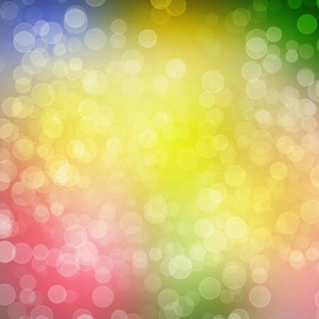 Multicoloured backdrop for greetings or invitations with blur bokeh Foto de archivo