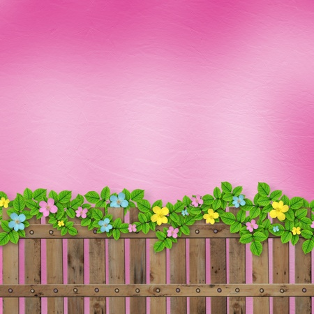 Wooden fence with a flower garland on the abstract background of a summer day  photo