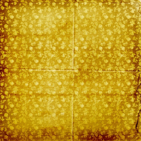 Grunge gold background with ancient floral ornament   photo