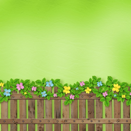 camomile flower: Wooden fence with a flower garland on the abstract background of a summer day