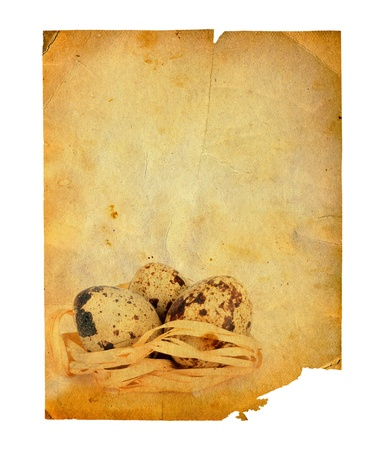 Grunge carved postcard with eggs to celebrate Easter on the white isolated background photo