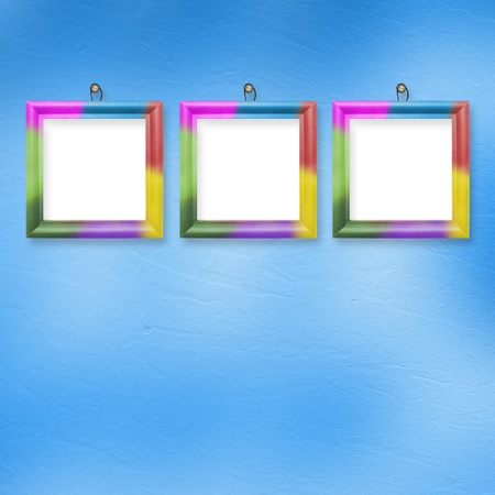 Multicolored bright frames hanging on the abstract pastel background photo