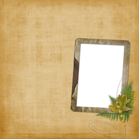 Abstract ancient brown background with old frame in scrapbooking style photo