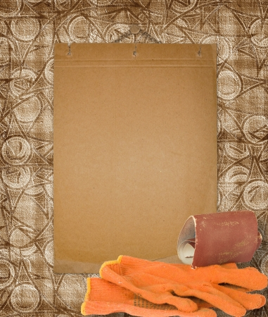 emery paper: The old form on a wall with gloves and an emery paper Stock Photo
